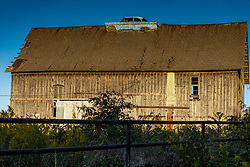 Barn with a car on the roof