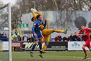 Dannie Bulman of AFC Wimbledon jumps with Scott Flinders (goalkeeper) of York City FC during the Sky Bet League 2 match between AFC Wimbledon and York City at the Cherry Red Records Stadium, Kingston, England on 19 March 2016. Photo by Stuart Butcher.
