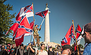 Confederate flags held by a group at Lee Circle who came to oppose Take Em Down Nola, a group that supports the removal of Confederate monuments in New Orleans that the city council voted to take down, included General Lee. 2