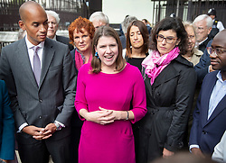 © Licensed to London News Pictures. 30/09/2019. London, UK. Liberal Democrat Leader Jo Swinson (C) stands with fellow MPs Chuka Umunna (L), Layla Moran and Sam Gyimah (R) as she makes a statement outside Parliament. Earlier a meeting of opposition leaders was held to discuss a plan to force the Prime Minister to go to Brussels to seek another Brexit delay as early as this weekend. Photo credit: Peter Macdiarmid/LNP