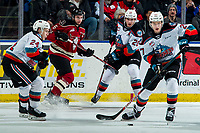 KELOWNA, BC - FEBRUARY 15: Jonas Peterek #27 of the Kelowna Rockets takes control of the puck from Dillon Hamaliuk #22 of the Kelowna Rockets and skates against the Red Deer Rebels at Prospera Place on February 15, 2020 in Kelowna, Canada. (Photo by Marissa Baecker/Shoot the Breeze)