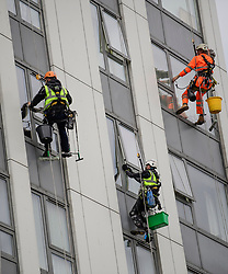 © Licensed to London News Pictures. 22/06/2017. London, UK. Window cleaners work next to cladding on a high rise building on the Chalcot Estate in north London, where cladding has been removed as part of an investigation in to fire safety at tower blocks. Prime Minister Theresa May has told Parliament that up to 600 high rise tower blocks may have similar cladding to that found in Grenfell Tower, which went on fire last week, in which as many as 79 residents are thought to have perished. Photo credit: Ben Cawthra/LNP