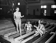 "Ackroyd 00025-22. ""Girls at Sport Show. May 7, 1947"" (bikini-clad girls with saws and woodworking tools)"
