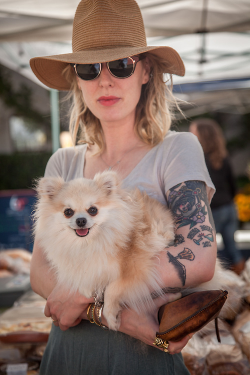Calistoga barber Sarah Schaefer with her 2 year old Pomeranian, June, at the Calistoga Saturday Market
