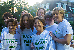 Westminster, London, June 6th 2016. Women MPs pose for a picture before their match as teams from uk industry as well as the House of Commons and the House of Lords compete in the annual McMillan Cancer Charity tug o' war.