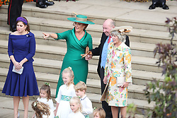 Princess Beatrice of York and Sarah, Duchess of York with Nicola and George Brooksbank after the wedding of Princess Eugenie to Jack Brooksbank at St George's Chapel in Windsor Castle.