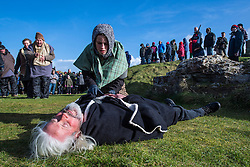 © Licensed to London News Pictures. 05/03/2017. PERRANPORTH, CORNWALL, UK.  St Piran dies in his own church at the end of the play.St. Piran's Day in Cornwall. St Piran is the patron Saint of Sinners in Cornwall and it is his flag that is recognised as the Cornish flag. Today his arrival from Ireland to Cornwall is celebrated across Cornwall especially in Perranporth where it is believed that he landed. He set up an Oratory and a Church the remains of which have been recently uncovered in the sand dunes at Perranporth..  Photo credit: MARK HEMSWORTH/LNP