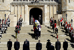 The Duke of Edinburgh's coffin, covered with His Royal Highness's Personal Standard is carried into St George's Chapel, Windsor Castle, Berkshire, followed by the Prince of Wales, the Duke of Cambridge, the Princess Royal, the Earl of Snowdon, Vice-Admiral Sir Timothy Laurence, the Earl of Wessex, the Duke of Sussex and the Duke of York during the funeral of the Duke of Edinburgh. Picture date: Saturday April 17, 2021.
