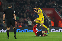 Football - 2018 / 2019 Premier League - Southampton vs. Crystal Palace<br /> <br /> Andros Townsend of Crystal Palace hurdles the tackle of Southampton's Jack Stephens during the Premier League match at St Mary's Stadium Southampton <br /> <br /> COLORSPORT/SHAUN BOGGUST
