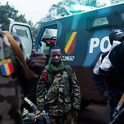 A Chadian child soldier with the FOMAC troop. <br /> <br /> Un enfant soldat du Tchad avec les troupes de la FOMAC. <br /> The FOMAC armed forces are composed of 2000 soldiers from Cameroun, Chad, Soudan, Gabon, and Congo-Brazzaville and are in charge of security within the country and demilitarization. There are a lot of tensions between the forces, especially coming from the Chadian side who tend to favoritize their citizens during the disarment process, and not take their weapons. Almost everyday, clashes happen between the forces, discrediting them in front of the civilians. <br /> <br /> La FOMAC est une force internationale armée, composée de 2000 soldats venant du Tchad, du Soudan, Cameroun, Gabon et Congo Brazzaville. Elle est en charge de la sécurité et de la démilitarisation. Il y a de nombreuses tensions à l'intérieur même de la force, notamment du coté Tchadien, qui tente de défendre les expatriés venant de leur pays pendant le processus de démilitarisation, et de ne pas récupérer leurs  armes. Presque tous les jours, des affrontements éclatent au sein même de la force, ce qui discrédite la force auprès des civils.
