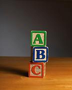 Still life of children's ABC toy blocks on butcher block table