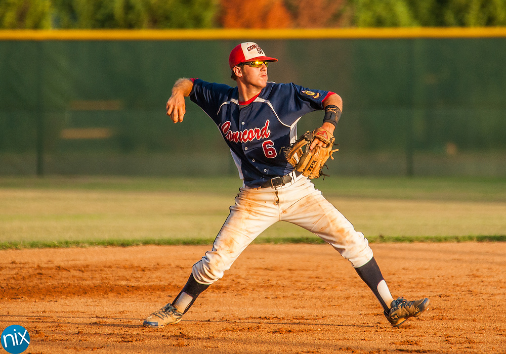 Concord Post 51's Brett Barrier throws a runner out against Rowan County Tuesday night at Central Cabarrus High School. Concord won the game 7-6 in the second game of a best-of-five game playoff series.