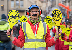 "© Licensed to London News Pictures. 31/01/2020. Bristol, UK. The ""Bristol Area Landing Crew"" at the ""No Bristol Airport Expansion"" march and rally in the city centre, organised by Bristol Airport Action Network (BAAN) and Extinction Rebellion Bristol. Bristol Airport, which is situated in North Somerset, has plans to increase capacity for 12 million passengers a year, up from its current capacity of 10 million by 2026, and their application is due to be considered at a special meeting of North Somerset's Planning and Regulatory Committee on February 10 at 6pm. North Somerset Council officers have recommended the application be approved despite more than 5,400 objections and around 2,200 letters of support. Objections have highlighted the detrimental effects for the local communities including increased air and noise pollution, increased traffic congestion and the loss of Greenbelt land around the airport, but the urgent need to tackle climate change is one of the main reasons why people are objecting. Photo credit: Simon Chapman/LNP."