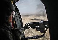 April, 9, 2009, An American blackhawk flies over and Iraqi oil field in An Nasiriyah Province in Iraq.