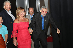 File photo - Actor Burt Reynolds is escorted by executive producer Michelle Hillery before the Student Showcase of Films Awards Show at Lynn University in Boca Raton, Fla. on Friday, April 6, 2018. 1970s' movie heartthrob and Oscar nominee Burt Reynolds has died at the age of 82. He reportedly passed away in a Florida hospital from a heart attack with his family by his side. Photo by Amy Beth Bennett/Sun Sentinel/TNS/ABACAPRESS.COM