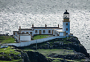 1909 Neist Point Lighthouse, on Isle of Skye, Scotland, United Kingdom, Europe. An aerial cableway takes supplies to the lighthouse and cottages. Since 1990, the lighthouse has been operated remotely from the Northern Lighthouse Board headquarters in Edinburgh. The former keepers' cottages are now in private ownership. Neist Point projects into The Minch strait and provides a nice walk and viewpoint.