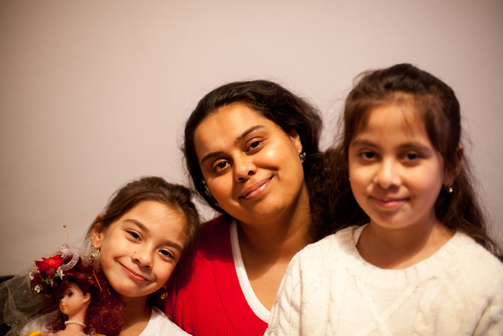 Portrait of mother and volunteer Anastazie Baudycka (28) with her daughters Nikola Holubova (6, left) and Anastazie Holubova (8) during a meeting with volunteers and mothers with their children for consultation and data collection regarding school enrolments in Ostrava. The meeting was in a volunteers flat.