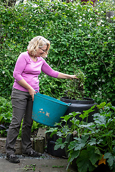 Adding material to a compost bin