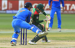 September 21, 2018 - Dubai, United Arab Emirates - Bangladesh cricketer Mushfiqur Rahim plays shot as Indian wicket keeper MS Dhoni tries  to stop the ball with his leg during the 1st cricket match of the Super four group  of Asia Cup 2018 between India and Bangaldesh at Dubai International cricket stadium,Dubai, United Arab Emirates on 21 September 2018. (Credit Image: © Tharaka Basnayaka/NurPhoto/ZUMA Press)