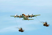 Israeli Air force Hercules 100 transport plane refuelling two Sikorsky CH 53 helicopters in flight. During the 60 independence day parade May 8th 2008