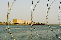 View through the razor wire across the Shatt al-Arab river from the back of the Shatt al-Arab Hotel, a British Military base during the iraq war. Shot in March 2005