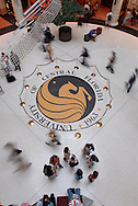 Students walk around the school seal in the rotunda of the Student Union building between classes at the University of Central Florida in Orlando, Florida.