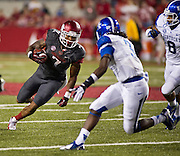 Kentucky Wildcats defensive back Fred Tiller (3) and linebacker Josh Forrest (8) pursue Arkansas Razorbacks running back Knile Davis (7) during the first half of a game at Donald W. Reynolds Razorback Stadium in Fayetteville, Ark., on Oct.. 13, 2012. Photo by Beth Hall