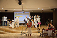 At the start of the Sünnet ceremony parents photograph their children and prepare them for the landmark day in a young Turkish boy's life. Circumcision Palace, Istanbul, Turkey