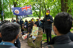 Edinburgh, Scotland, UK. 12 June 2021. A pro democracy rally was held this afternoon on The Meadows in Edinburgh by Hong Kong people resident in Scotland. Protesting against draconian anti-democracy laws imposed on Hong Kong by Beijing. The protesters were a mix of long term residents, students and recent arrivals who have taken advantage of the UK government's special visa scheme to allow Hong Kong residents to emigrate to the UK. Iain Masterton/Alamy Live News