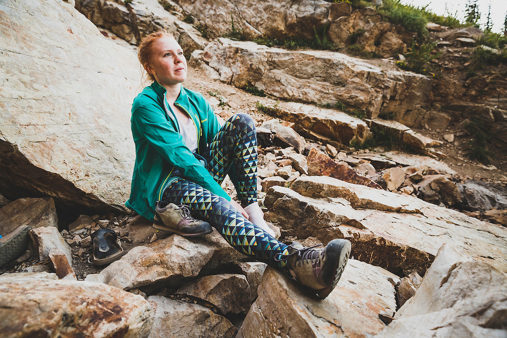 After an evening of climbing Zoe keithley puts on her approach shoes, Creekside Wall, Albion Basin, Utah.