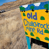 030113       Cable Hoover <br /> <br /> A homemade sign commemorates the old Church Rock Mine road near N.M. Highway 566 Saturday.