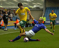 Photo: Matt Bright/Sportsbeat Images.<br /> Millwall v Hartlepool United. Coca Cola League 1. 03/11/2007.<br /> James Brown of Hartlepool skips over a challenge from Andy Frampton of Millwall