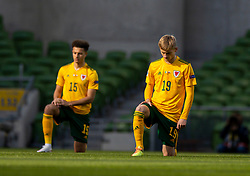 DUBLIN, REPUBLIC OF IRELAND - Sunday, October 11, 2020: Wales' Matthew Smith kneels down (takes a knee) in support of the Black Lives Matter movement before the UEFA Nations League Group Stage League B Group 4 match between Republic of Ireland and Wales at the Aviva Stadium. The game ended in a 0-0 draw. (Pic by David Rawcliffe/Propaganda)