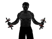 one man topless muscular exercising body building weights training in silhouettes on white background