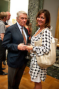 Don McCullin; ; Catherine Fairweather, Tate Britain Summer party. Tate. Millbank. 27 June 2011. <br /> <br />  , -DO NOT ARCHIVE-© Copyright Photograph by Dafydd Jones. 248 Clapham Rd. London SW9 0PZ. Tel 0207 820 0771. www.dafjones.com.