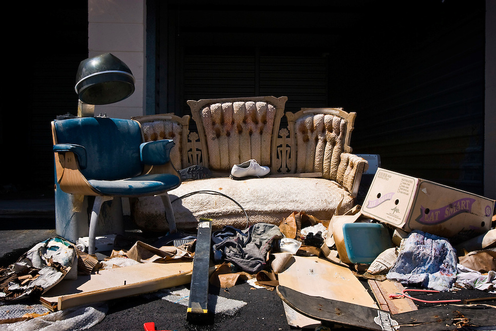 Hair dryer and antique sofa left behind at Security Self Storage that suffered major damage due to Hurricane Katrina flooding in New Orleans East, Louisiana.