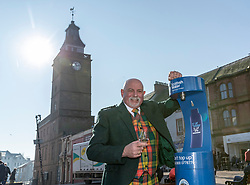 Youngsters paid tribute to one of Dumfries' most celebrated former residents when they unveiled a new water refill tap in the town.<br /> <br /> The high tech Top Up Tap has been installed by Scottish Water as part of its national initiative to encourage people to carry a reusable bottle and stay hydrated on the go. <br /> <br /> Pictured: Brian Gibson from one of the town's oldest businesses, whisky and wine specialists TH Watson. The experts, who run the area's Drambusters Whisky Club, sampled water from the new tap.