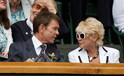 30.06.2011, Wimbledon, London, GBR, WTA Tour, Wimbledon Tennis Championships, im Bild Singer Cliff Richard reads the programme whilst television presenter Gloria Hunniford watches from the Royal Box during day ten of the Wimbledon Lawn Tennis Championships at the All England Lawn Tennis and Croquet Club. EXPA Pictures © 2011, PhotoCredit: EXPA/ Propaganda/ David Rawcliffe +++++ ATTENTION - OUT OF ENGLAND/UK +++++