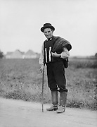 Elderly Bavarian Man with Stick Standing at the Roadside, 1921