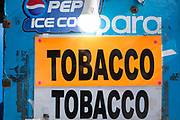 A detail of a street vendor's kiosk notices for tobacco, on 5th March 2019, in London, England.