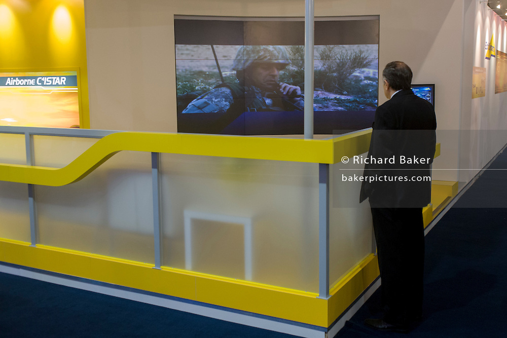 Delegates watch PR films at the electronics company Elbit Systems UK's trade stand during the Farnborough Air Show.