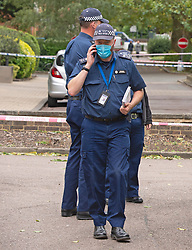 ©Licensed to London News Pictures 26/09/2020  <br /> Norbury, UK. Police search teams on scene. Police have cordoned off an area in front of Andersons Heights in Norbury, South London where the gunman who shot Sgt Ratana was arrested for having ammunition. A murder investigation has been launched by police after the death of custody police sergeant Matt Ratana at the Croydon Custody Centre in South London yesterday.Photo credit:Grant Falvey/LNP