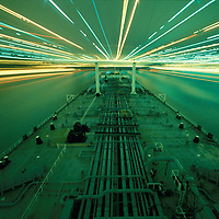 USA, California, Time exposure of oil tanker sailing under Carquinas Bridge while approaching oil refinery