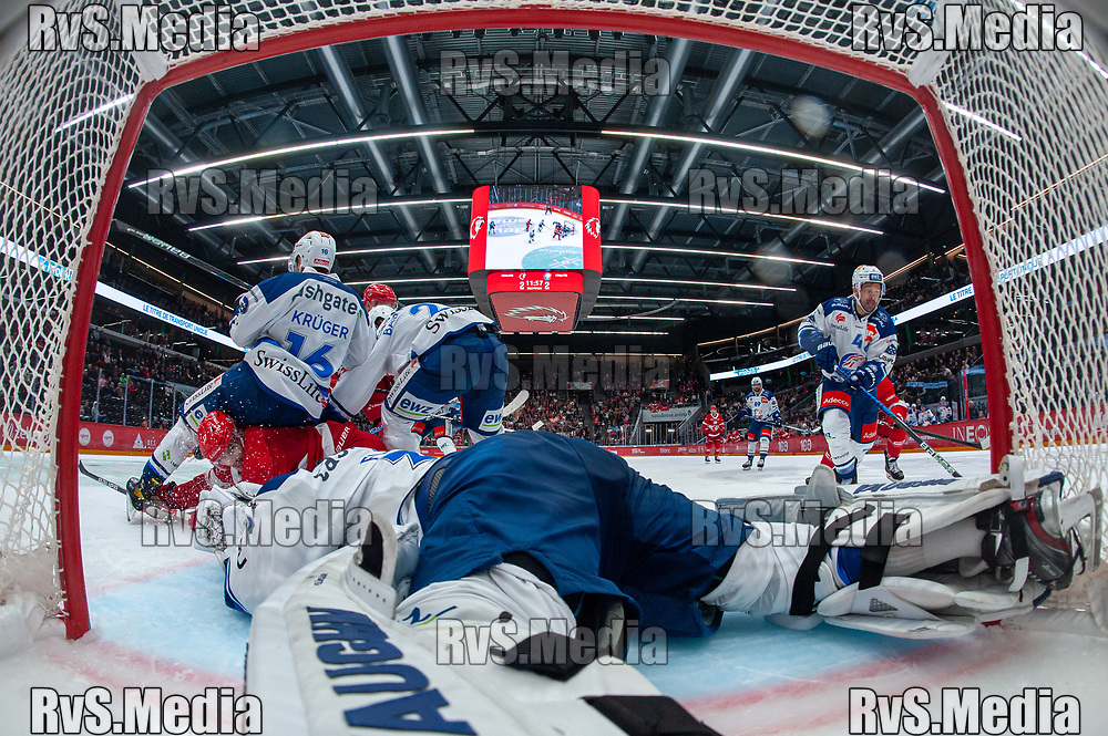 LAUSANNE, SWITZERLAND - OCTOBER 01: Ken Jager #17 of Lausanne HC clashes with Chris Baltisberger #14 of ZSC Lions during the Swiss National League game between Lausanne HC and ZSC Lions at Vaudoise Arena on October 1, 2021 in Lausanne, Switzerland. (Photo by Monika Majer/RvS.Media)