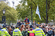 "Protesters gather and hold placards during a ""Match the Million"" march for free speech, free assembly, and freedom from lockdowns outside Downing Street in Central London, on Saturday, Oct 10, 2020. (VXP Photo/ Vudi Xhymshiti)"
