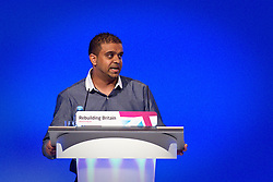 © Licensed to London News Pictures. 30/09/2012. Manchester, UK . Usman Ali from Manchester speaks from the podium . Labour Party Conference Day 1 at Manchester Central . Photo credit : Joel Goodman/LNP