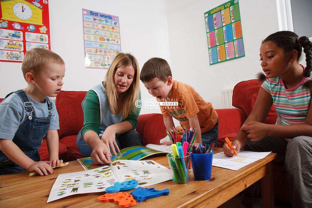 Nursery nurse playing with children