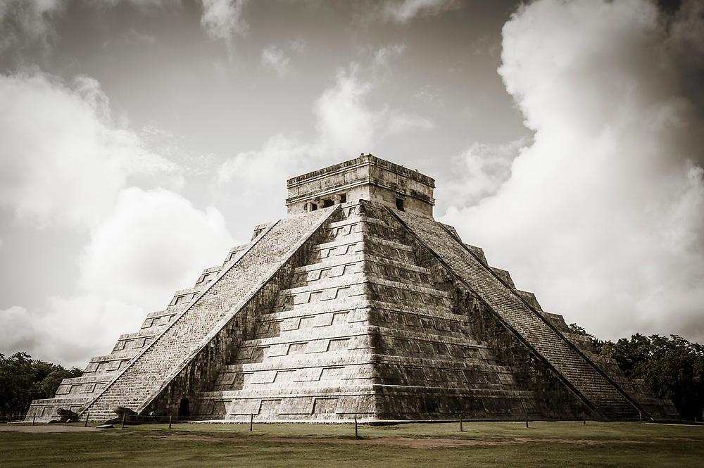 The north and west sides of the Kukulkan Pyramid (El Castillo) at the Chichen Itza world heritage site, Yucatan, Mexico