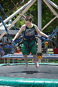 Close up of a young boy of 7 on a bungee trampoline