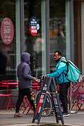 "Following the government decision to reopen Britain, the picture shows ""Deliveroo"" bicycle units who said they have little to no jobs in the city of Manchester on Wednesday, April 28, 2021. Manchester is part of the UK to lift some of the restrictions designed to stop the spread of Covid-19. (Photo/ Vudi Xhymshiti)"
